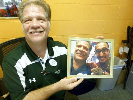 Keith Stainbrook shows an autographed photo of a selfie he took with actor and basketball player Luis Da Silva. Da Silva visited Palmyra in June to buy a Corvette from Stainbrook at the Klick-Lewis dealership.