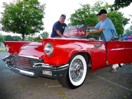 Don Stoudt Jr., left poses with the 1957 Thunderbird his father, Don Stoudt Sr., restored. The car will be on display Saturday at Hilltop Playground's Sixth Annual Car Show.
