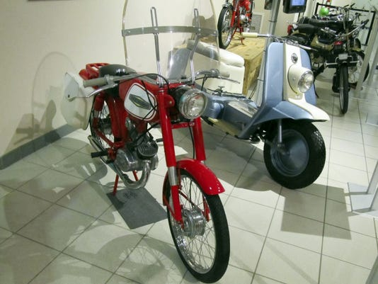 A Harley-Davidson motorbike and scooter are part of the Motorbikes for the Masses exhibit at the AACA Museum.