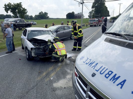 Emergency personnel check two of the three vehicles involved in a crash just before 4 p.m. Wednesday on Route 419 at State Drive in South Lebanon. There were no injuries.