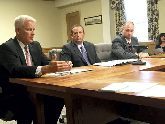 Financial consultant Jay Wenger explains to the Lebanon County commissioners how the county will benefit by making a 10 million contribution to its employee pension fund as pension fund advisers Mike Battistelli (center) and Brett Holland listen. John Latimer -- Lebanon Daily News