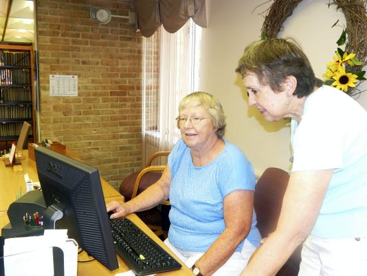 Cornwall Manor and Lebanon Community Library recently announced a partnership. Connie Godleski, Cornwall Manor's library coordinator, right, shows the Polaris System to Judy Feather, Gateway Library volunteer. The Gateway Library, which is run by volunteers, containes 4,000 books