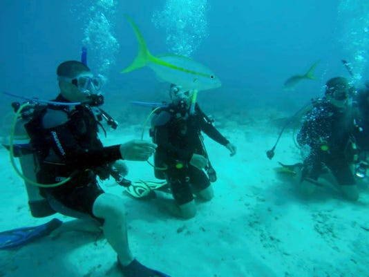 Naval Sea Cadets Anthony Anazagazty, left, and Benjamin Kutz, both of Lebanon, participate in scuba training this summer in Florida.