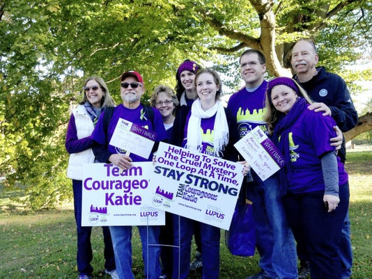 Katie Bamberger surrounded by team members. Her sister Jessie Styers (far right) was the driving force in starting the team.  Submitted