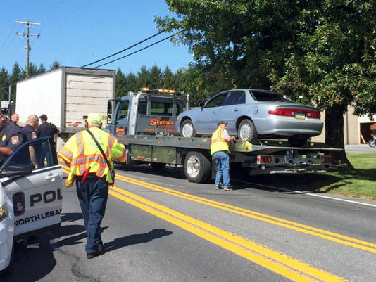 North Lebanon Township crash: A car that was involved in a crash with a tractor-trailer on North 15th Avenue in North Lebanon Township is secured onto a tow truck. The crash happened at 1:20 p.m. Thursday just north of northern most Wal-Mart entrance. The driver was transported to a hospital. A police report was not immediately available.