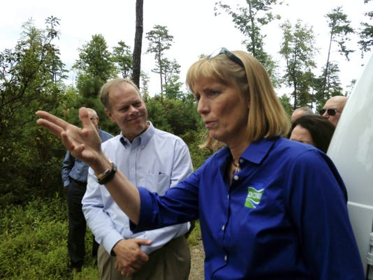 Cindy Adams Dunn, secretary of the Department of Conservation and Natural Resources, talks about Pennsylvania's forestry industry Wednesday as Franklin County Commissioner Bob Ziobrowski listens during a visit to Michaux State Forest.