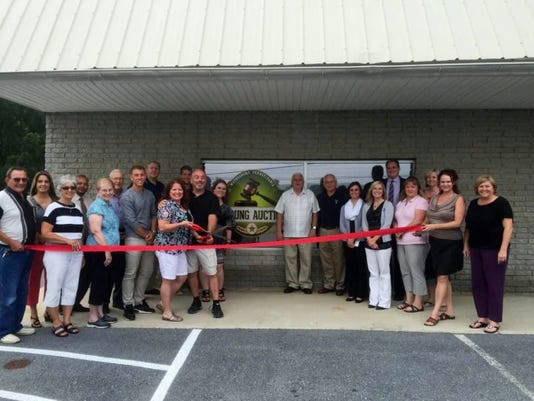 DeYoung Auctions celebrated the ribbon-cutting on July 17 for its new location, 10989 Anthony Highway, Waynesboro. From left, Harold Waltz, Carolyn Waltz, Jackie Poor, Adam DeYoung, Brenda DeYoung, Jim DeYoung. Behind them are Carrie Heckman, Rod Irish, Bob Poor of the Waynesboro Area Chamber of Commerce, Joey Nunemaker and Karissa DeYoung Nunemaker. Various officials from the Waynesboro Area Chamber of Commerce are pictured on the right side, including Amy Byers (in the back, third from the right), and Executive Director Jackie Mowen on the end.