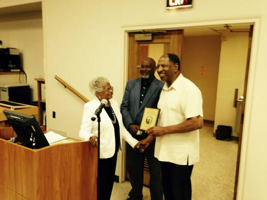Sam King, right, chats with Jenny and Donald Waters on Monday evening after accepting the 2015 Mike Waters Citizen of the Year Award. Jenny and Donald Waters are the widow and son of Mike Waters, for whom the award was established following his death in 1999.