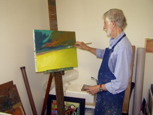 Paul Saberin at work on a painting. Submitted