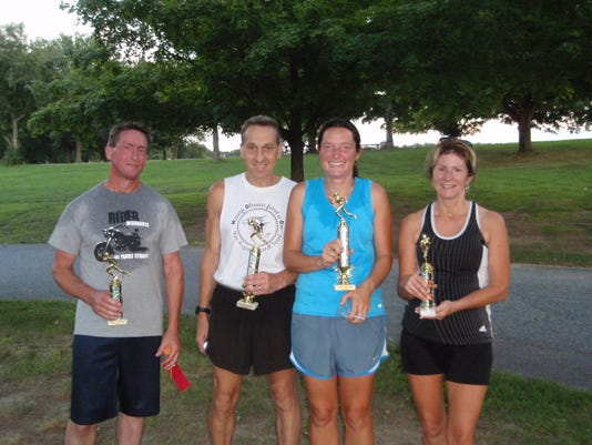 The South Penn Road Runners Club recently awarded trophies to the first- and second-place finishers for the group's summer series. Lindsay Krone finished first for the women, followed by Debbie Sullivan. For the men, Pete Dodd was first, and Jim Plank was second. Pictured from left are Plan, Dodd, Krone and Sullivan.