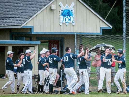 Glen Rock's Connor Hood (17), right, is greeted by teammates after scoring against Mount Wolf during the first game of the Central League championship series on Aug. 18. Glen Rock won 2-1.