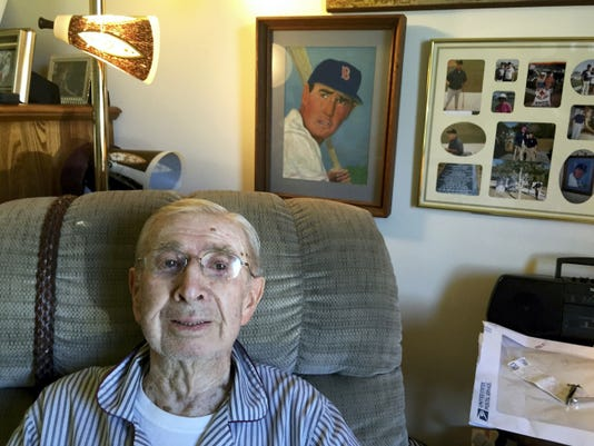 Don Gentzler in his room at Senior Commons, an oil painting of Ted Williams over his shoulder. Gentzler's nephew did the painting for his uncle.