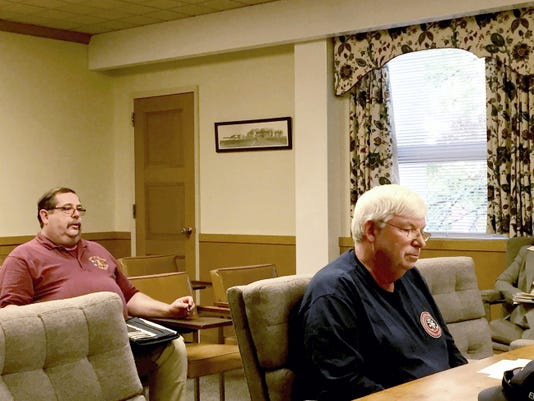 Ebenezer Fire Co. President Lee Spencer (right) listens as Lebanon County Emergency Management Agency Director John Wilson addresses the Lebanon County commissioners about the fire company's repetitive siren problem on Thursday. John Latimer -- Lebanon Daily News