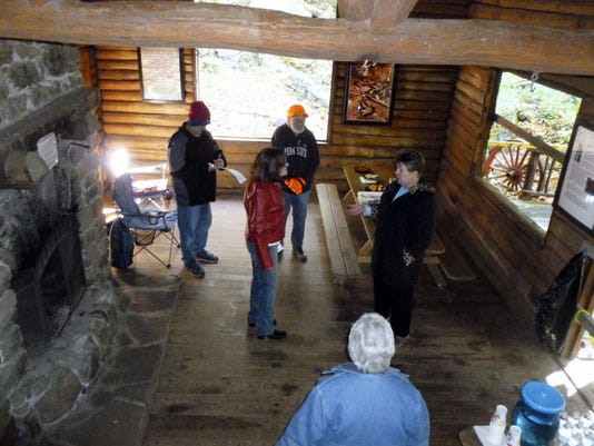 Jo Ellen Litz, right, president of the Swatara Watershed Association and a county commissioner, tells visitors inside the Armar Bordner cabin about the efforts to save the historic structure. SWA's lease on the cabin in Swatara State Park expires at the end of the year.