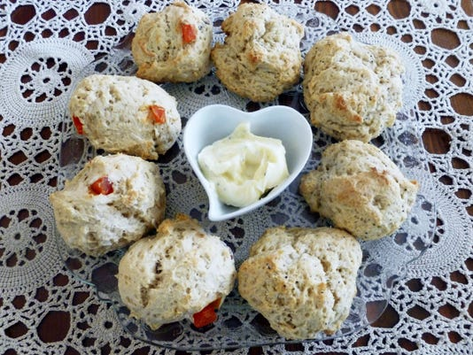 Tray of scones made with ricotta. Strawberry shortcake on right. Scones on left a variation, Pecan with dried mango chips. Honey, butter topping in center. Ready to be served with a cup of tea!