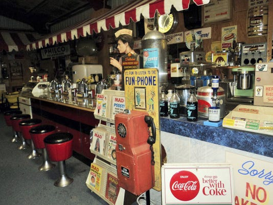 Visitors can buy sodas and more at a vintage soda fountain in The Old Sled Works in Duncannon, pictured in June 2015.
