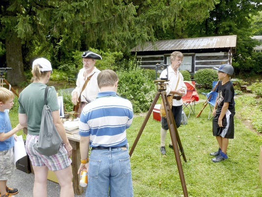 British surveyors Charles Mason and Jeremiah Dixon are portrayed by Bob Angle (in tri-corner hat) and Wayne Twigg (behind tripod) at a historical event in 2014 in Blue Ridge Summit. Angle and Twigg will portray the surveyors Aug. 29 at a historical program at Mary Penn B&B, Gettysburg.