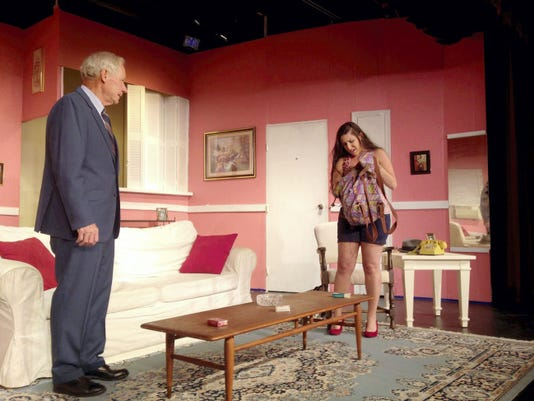 """James Robert Clark, playing Barney Cashman, talks to Courtney McDougall, playing Bobbi, on Tuesday during a rehearsal of """"Last of the Red Hot Lovers"""" on Tuesday at Hanover Little Theatre."""