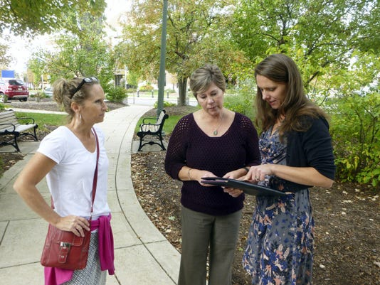From left, Eileen Voyles and Susan Cort, volunteers with the Downtown Hershey Association, discuss the Choctoberfest event with Lauren Zumbrun, economic development manager for Derry Township. The three are standing in Chocolatetown Square park, where the event will be held Oct. 17.