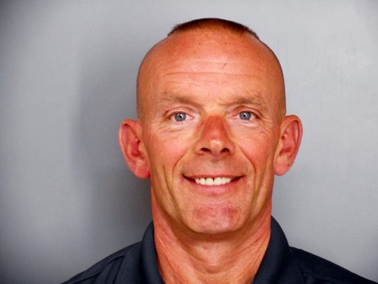 FILE - This undated file photo provided by the Fox Lake Police Department shows Lt. Charles Joseph Gliniewicz. Authorities will announce Wednesday, Nov. 4, 2015, that the northern Illinois police officer whose shooting death led to a massive manhunt in September killed himself, an official briefed on the crime investigation says. (Fox Lake Police Department photo via AP, File)