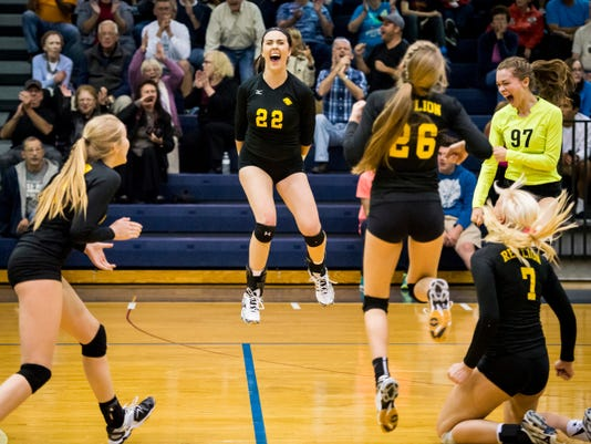 Red Lion's Lauren Enfield (23), Rachel Groff (22), Jenna Enfield (26), Emily Sterner (97) and Lindsey Blevins celebrate a first set win against Central York in the District 3 Class AAA volleyball quarterfinal at Dallastown Area High School on Tuesday.