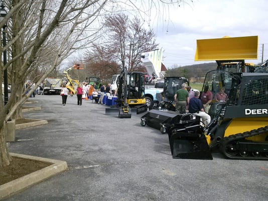 Visitors check out the latest equipment at the Pennsylvania State Association of Township Supervisors annual conference in Hershey on Monday. To see Tout video from Hershey, visit LDNews.com.