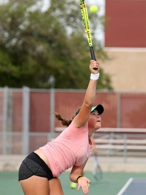 Rachel Denny Clow/Caller-Times Flour Bluff's Femke Tjon-A-Joe serves in the girls single final of the District 30-5A Tennis Tournament on Friday at Tuloso-Midway High School.