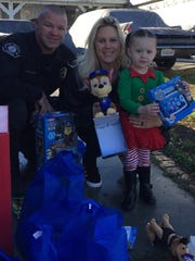 Simi Valley police officer Kristen Mesa and K-9 officer Jason Wilkinson visited a 2-year-old girl whose favorite Christmas decoration was vandalized.