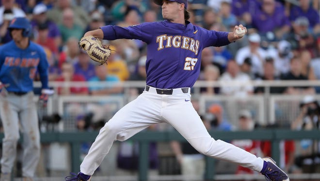 Jun 26, 2017; Omaha, NE, USA; LSU Tigers pitcher Nick Bush (29) pitches against the Florida Gators in the fourth inning in game one of the championship series of the 2017 College World Series at TD Ameritrade Park Omaha. Mandatory Credit: Steven Branscombe-USA TODAY Sports