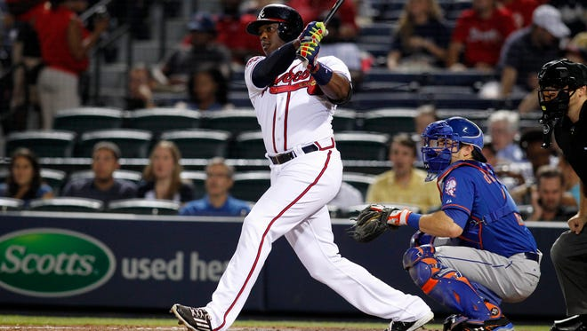 Sept. 19, 2014: Atlanta Braves slugger Justin Upton (8) hits a single against the New York Mets in the fourth inning at Turner Field.