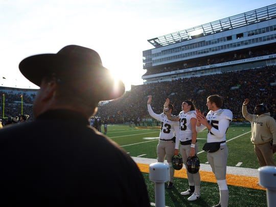 Purdue teammates wave to patients at the University