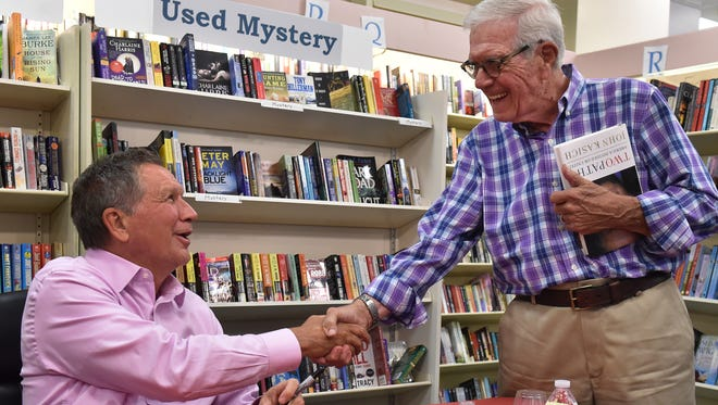 """John Kasich (left), governor of Ohio and former presidential candidate, shakes hands with Phillip Slaymaker, of Vero Beach, during a book signing for Kasich's new book, """"Two Paths: America Divided or United,"""" on Thursday, May 25, 2017, at the Vero Beach Book Center. """"I liked him a lot; he's honest and he's real, and he wants nothing but good for the whole country,"""" Slaymaker said."""
