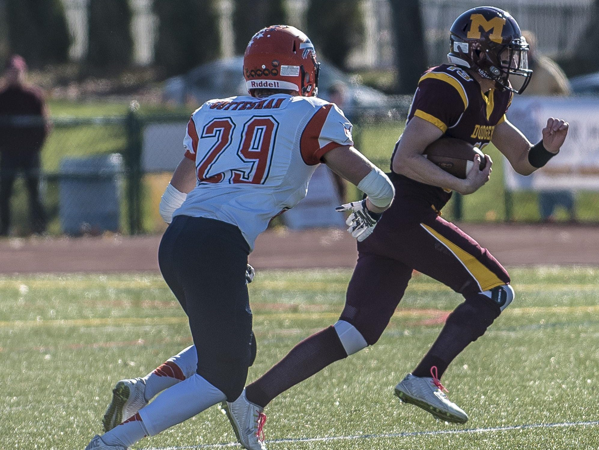 Laker Dylan Gottesman (29) chases Madison runner Nick Coviello (13) at the NJSIAA North 2 Group II opening round playoff at Madison High in Madison, November 14, 2015.