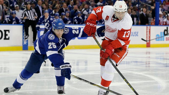 Lightning defenseman Matt Carle (25) knocks the puck away from Red Wings center Pavel Datsyuk during the third period of the Wings' 3-2 in Game 1 of the Eastern Conference quarterfinals Wednesday in Tampa, Fla.
