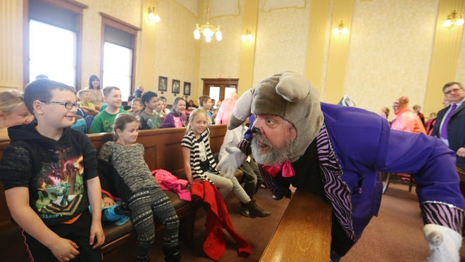In this April 2016 photo, Manitowoc County Courthouse performs a mock criminal trial involving the Big Bad Wolf and the Three Little Pigs to celebrate National Law Day.