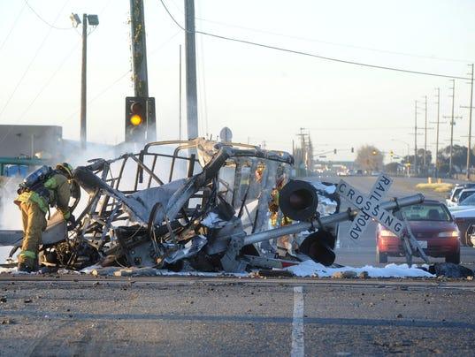 Train derailment car crash aftermath