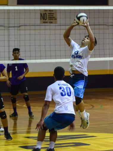 In this file photo, Notre Dame Royals' starting setter Gaven Leon Guerrero sets up a teammate as the Royals took on the George Washington Geckos.
