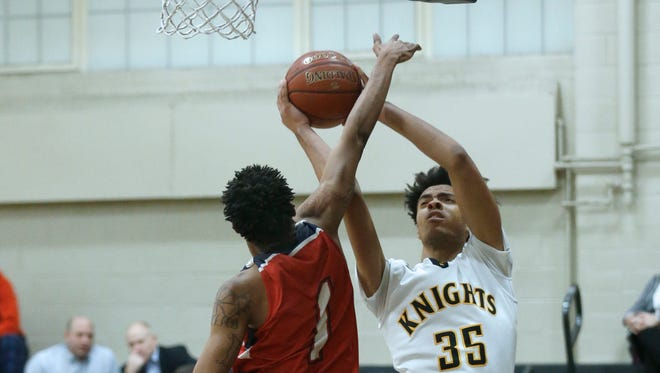 Northeast Douglass' Larry Young contests a shot from McQuaid's Cam Wilson earlier this season.
