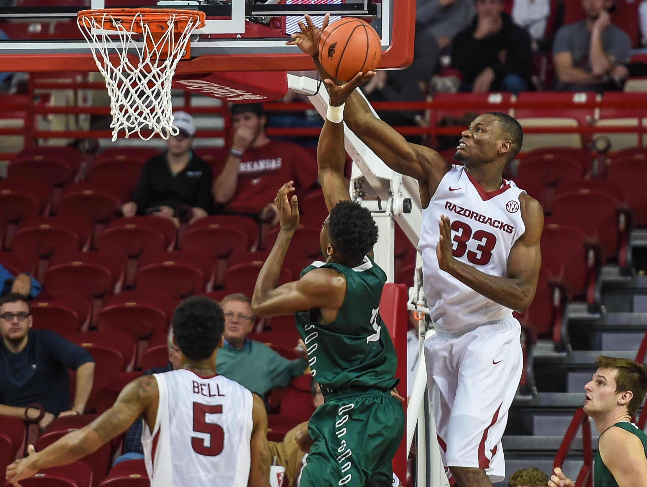 Arkansas' Moses Kingsley (33) makes a block against Delta State on Tuesday night in Fayetteville.