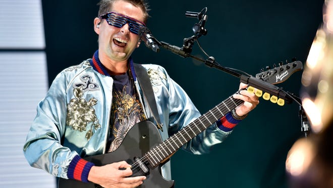 Matt Bellamy of Muse performs on day one at Lollapalooza in Grant Park on Thursday, Aug. 3, 2017, in Chicago. The band played three songs and then park officials evacuated the festival due to inclement weather.