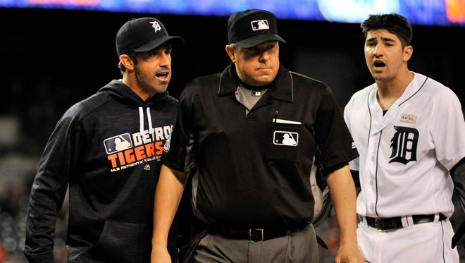 After being ejected, Tigers manager Brad Ausmus has words with home plate umpire Doug Eddings in the fourth inning and Nick Castellanos joins in, right.