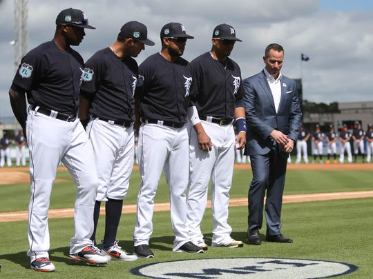 """From left: The Tigers' Justin Upton, Ian Kinsler, Francisco Rodriguez , Victor Martinez and Chris Ilitch stand by the """"Mr. I"""" logo in honor of owner Mike Ilitch, who died Feb. 10, before action against Baltimore on Friday, Feb. 24, 2017 at Publix Field at Joker Marchant Stadium in Lakeland, Fla."""