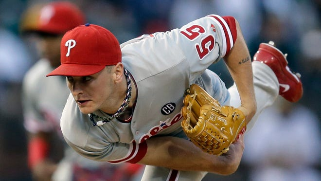 The Phillies' David Buchanan works against the Oakland Athletics in the first inning Friday in Oakland, Calif.