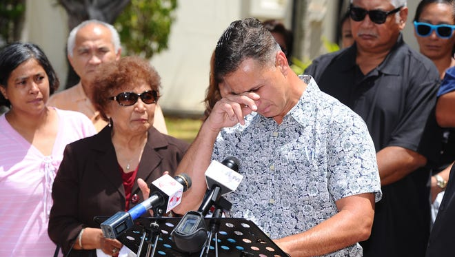 Walter Denton, 52, wipes tears from his eyes as emotions overcome him as he speaks during a press conference outside the Cathedral Pastoral Center in Hagåtña on Tuesday, June 7. Denton, surrounded by friends, family and supporters, talked about being sexually abused in April 1977, by then-Father Anthony Apuron when he served as an altar boy at the Agat Church. 'I was raped by Anthony Sablan Apuron, who at (this), at that time was a priest at Agat and whom I trusted...,' stated Denton in his opening remarks.
