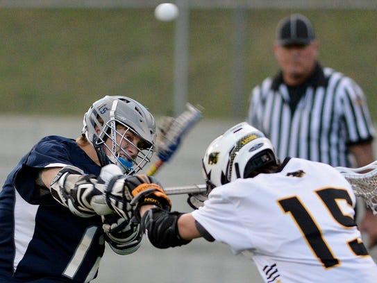 Dallastown's Tanner Haines take a shot on goal while