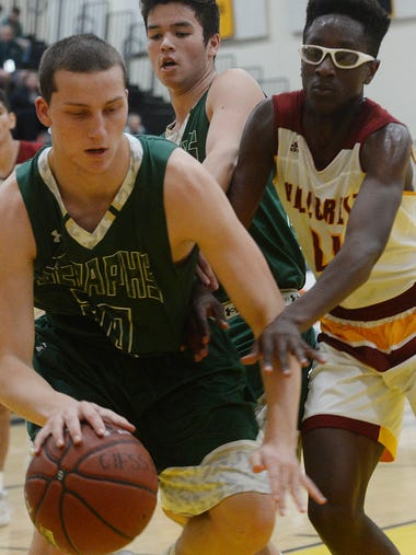 St. Bonaventure's Zach Kenny drives to the basket against
