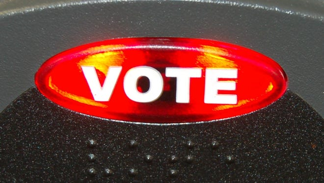 The red 'vote' button on top of the voting machine lights up when a voter is ready to cast their ballot.