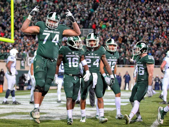Michigan State offensive tackle Jack Conklin (74) and