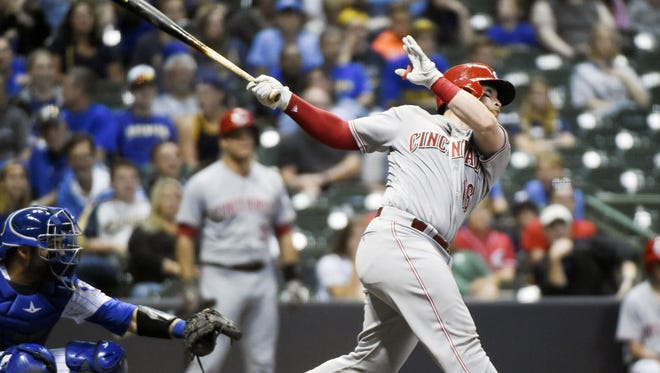 Tucker Barnhart hit a solo homer in the seventh inning of Friday's 11-10 Reds victory over the Brewers.