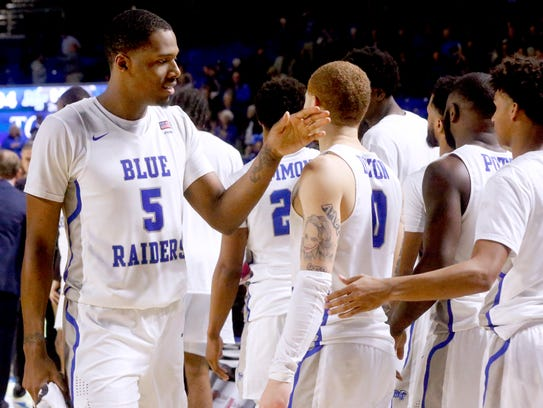 MTSU's Nick King (5) and Donovan Sims (3) celebrate